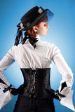 Rear view of attractive girl in corset royalty free stock photography