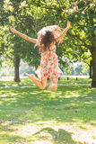 Rear view of attractive stylish brunette jumping in the air Stock Image