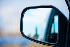 Rear view auto mirror blurred object warning Stock Photos
