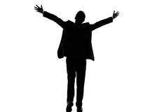 Rear view back business arms outstretched man silhouette. One caucasian business man rear view back arms outstretched in silhouette on white background Stock Photo