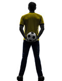 Rear view back man holding soccer football silhouette Royalty Free Stock Images