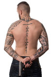 Rear View Of Back Tattooed Man With Gun. Back Rear View Tattooed Male With Gun On Isolated On White Background Royalty Free Stock Photo