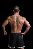 Rear View Of Back Tattooed Man. Back Rear View Tattooed Male On Isolated Black Background Royalty Free Stock Photography