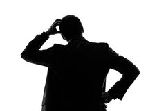 Rear view back thinking business man silhouette Royalty Free Stock Photo
