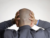 Rear view from a bald head. Rear view from stressed bald head man,holding his head Royalty Free Stock Photos