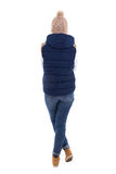 Rear view of beautiful blond woman in warm clothes posing isolat Stock Images