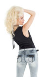 Rear view of a beautiful casual blond posing Royalty Free Stock Photos