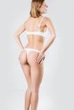 Rear view of beautiful caucasian woman in white bikini, isolated Stock Image