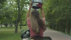 Pretty blond girl enjoying motorbike ride outdoor stock footage
