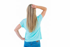 Rear view of a blonde posing with hand on hip Stock Photo
