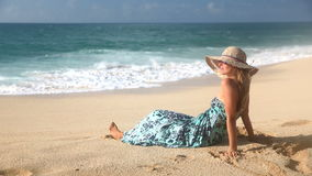 Rear View Of Blonde Woman Sitting On The Beach And Looking At The Ocean stock video