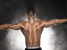 Rear view of bodybuilder Stock Images