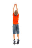 Rear view boy jumping. Rear view of young boy jumping isolated on white background Stock Photo