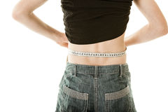 Rear view of boy measuring waist with tape measure Stock Photos