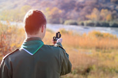 Rear View of a Boy Scout Holding a Compass Royalty Free Stock Photos