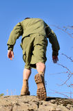 Rear View of A Boy Scout Walking on Top of a Rock Stock Photos