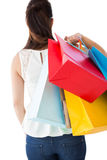 Rear view of brown hair holding shopping bags Stock Image