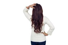 Rear view of brunette with hand on hair Royalty Free Stock Image
