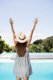 Rear view of brunette raising hands Stock Photography