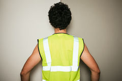 Rear view of builder in high visibility vest Royalty Free Stock Image