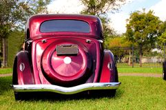 Rear view of burgundy classic car Royalty Free Stock Photo
