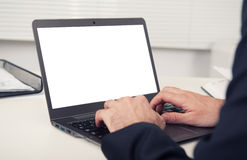 Rear view of business man hands using laptop. Rear view of business man hands busy using laptop at office desk, with copyspace Stock Image