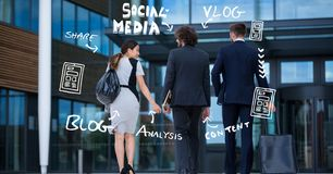 Rear view of business people with icons outside office Stock Image