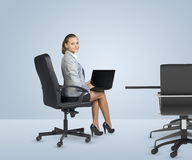 Rear view of businesslady sitting at table Stock Images