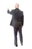 Rear view of a businessman blaming somebody Stock Photo