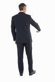 Rear view of a businessman doing gesture Stock Images