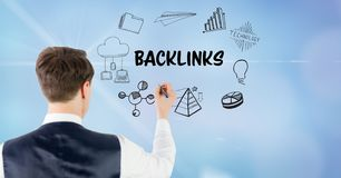 Rear view of businessman drawing backlinks icons. Digital composite of Rear view of businessman drawing backlinks icons Royalty Free Stock Photos