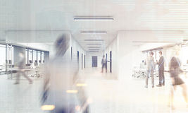 Rear view of businessman entering a busy office with long corrid Royalty Free Stock Photo