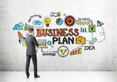 Rear view of businessman looking at business plan Stock Photography