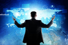Rear view of businessman looking at digital screen Stock Photography