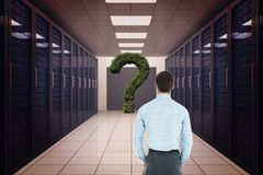Rear view of businessman looking at question mark Royalty Free Stock Images
