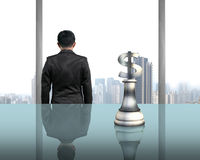 Rear view businessman with money symbol piece on table Stock Images