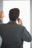 Rear view of businessman phoning Stock Photography