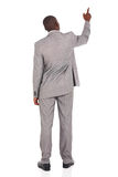 Rear view businessman pointing Stock Photo