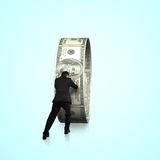 Rear view businessman pushing money circle Royalty Free Stock Images