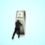 Rear view businessman pushing money circle Royalty Free Stock Images