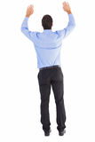 Rear view of businessman raising his arms Royalty Free Stock Photos