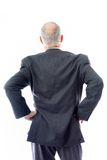 Rear view of a businessman standing with his arms akimbo Stock Photos