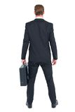 Rear view businessman standing with his briefcase Royalty Free Stock Photography