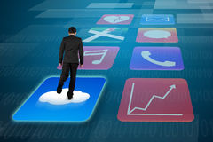 Rear view businessman surfing on shiny app icons tech background Stock Photos