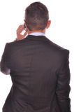 Rear view of businessman talking on his smartphone Royalty Free Stock Photos