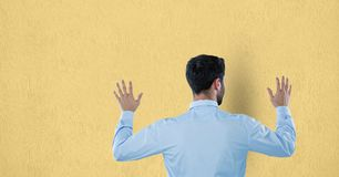 Rear view of businessman touching wall Royalty Free Stock Image