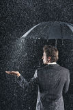 Rear View Of Businessman Under Umbrella Royalty Free Stock Photography