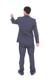 Rear view of businessman using a marker Royalty Free Stock Photography