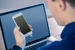 Rear view of businessman using smartphone Stock Photo