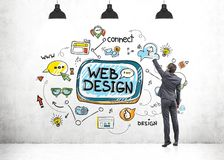 Rear view of businessman drawing web design sketch Royalty Free Stock Photos